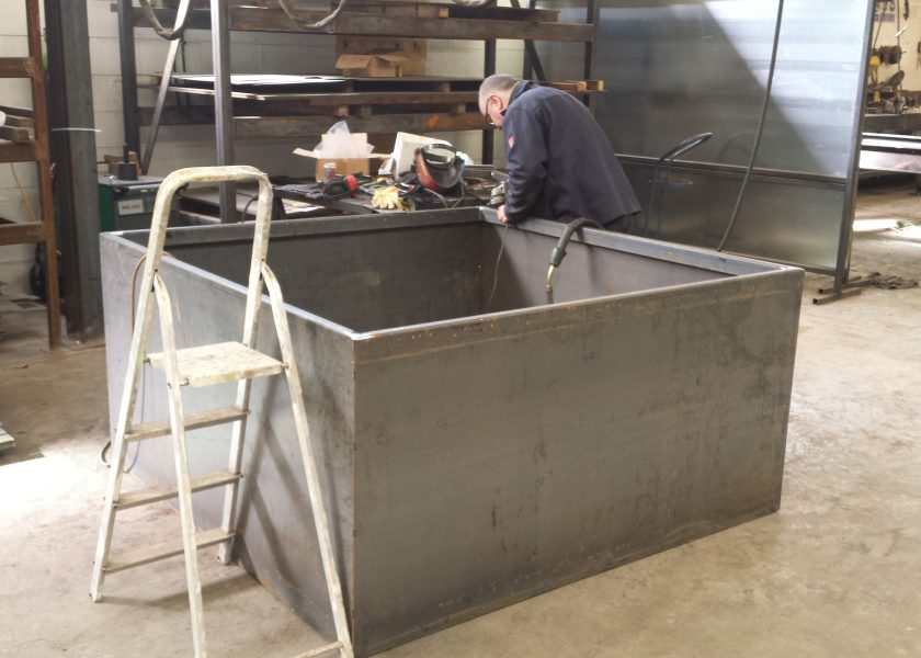 Man manufacturing steel planters